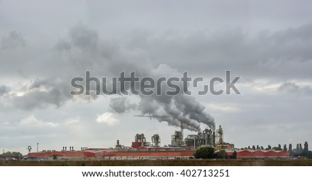 Smoke from factory pipes. Environmental pollution - stock photo