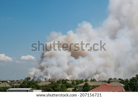 Smoke from fires in the city - stock photo
