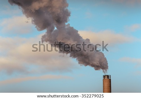 Smoke from high pipes, industry, environmental pollution in Helsinki, Finland. Polution concept. - stock photo