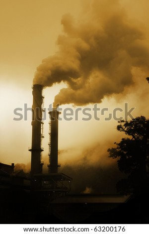 smoke from smoke stack representing pollution - stock photo