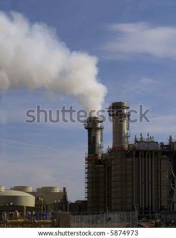 Smoke from stack at power plant - stock photo
