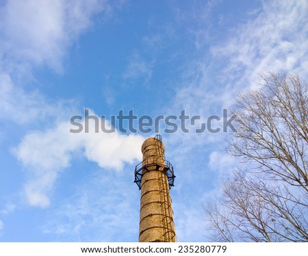 Smoke from the chimney. - stock photo