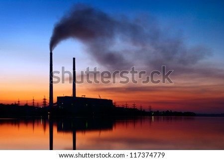 smoke from the chimney of the plant pollute - stock photo
