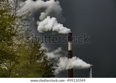 smoke from the pipes against the sky