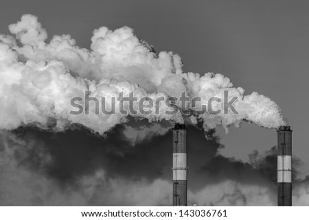 Smoke from the pipes of heat station - Moscow (black and white) - stock photo