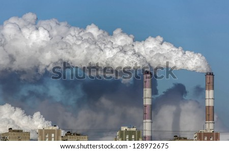 Smoke from the pipes of heat station - Moscow, Russia - stock photo