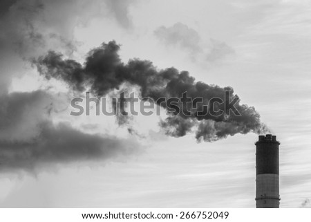 Smoke from the pipes of heat station - Moscow, Russia (black and white) - stock photo