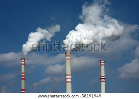 smoke from three coal power plant chimney - stock photo