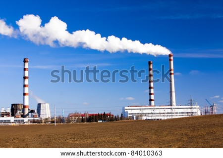 Smoke going from the pipes located at factory on manufacture of chemical production (Grodno) - stock photo