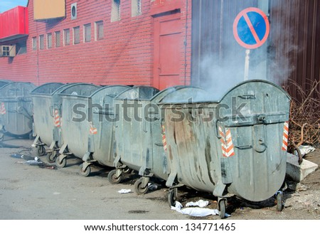 Smoke in container. Selective focus on the first container with smoke - stock photo