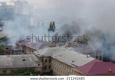 Smoke in the city of Ukraine - stock photo