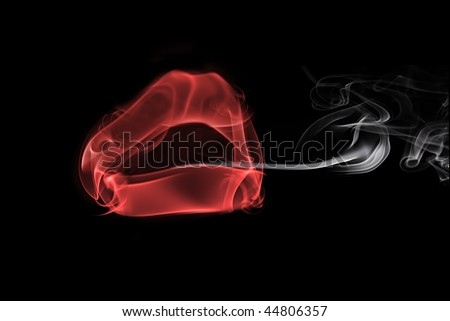smoke in the form of female lips, smoking a cigarette - stock photo