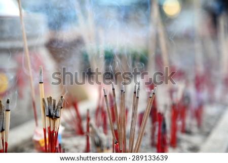 smoke incense in shrine - stock photo