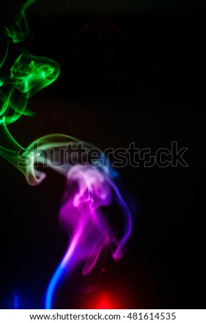 Smoke lit with Red, Blue, and Green LED lights on a black background.