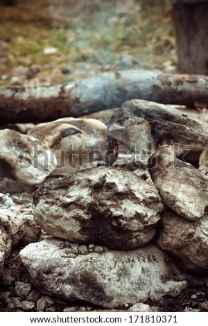 Smoke of Fire with burnt stones Outdoor natural moody background tourism vacations concept - stock photo