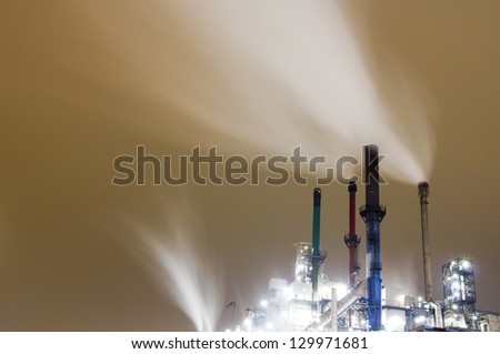 Smoke originating from an industrial plant - stock photo