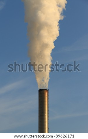 Smoke out of an industrial chimney.