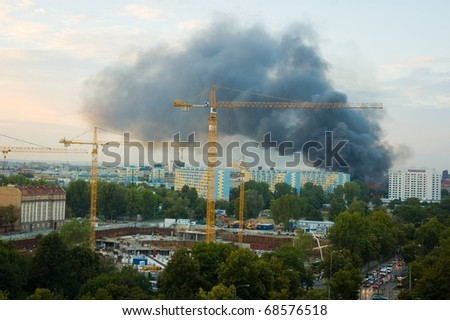 Smoke over the city - fire in Wroclaw - stock photo
