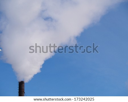 smoke pipe against clear blue sky