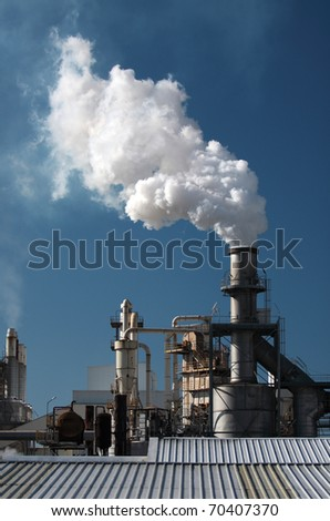 Smoke Pipe in the Factory - stock photo