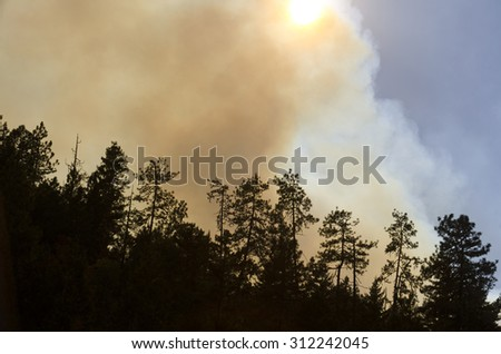Smoke rises and obscures sun from one of the large fires that the northwest this year - stock photo