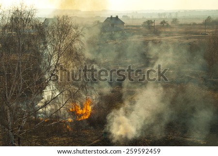 Smoke rises from the fires and fills up the whole area. - stock photo