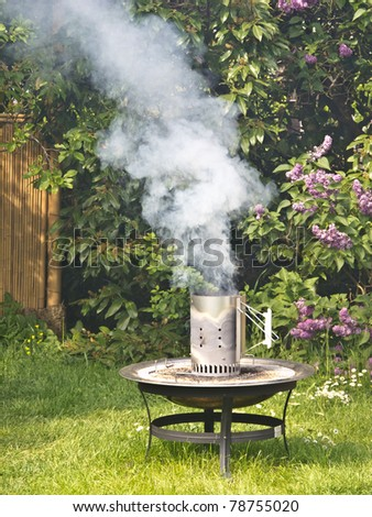 Smoke rising from a fire bowl - stock photo