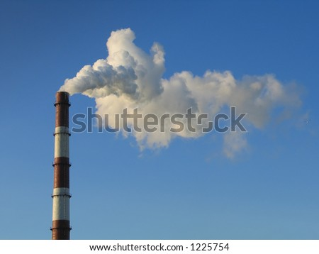 smoke stack on a blue sky background - stock photo