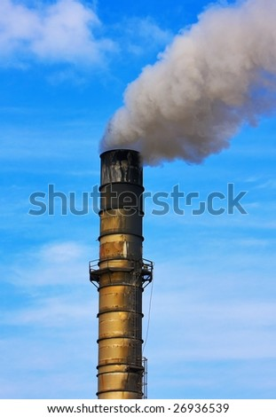 Smoke Stack with Pollution Plume Against Blue Sky - stock photo