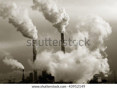 Smoke stacks polluting the planet - stock photo