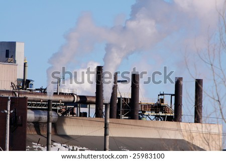 smoke stacks pollution environmental damage - stock photo