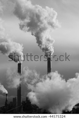 Smoke stacks with Industrial Emissions impacting the Environment - stock photo