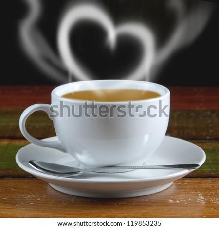 Smoke sweet heart coffee on the wood table - stock photo