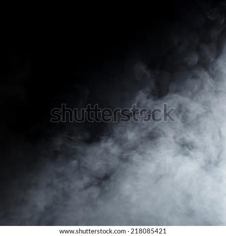 Smoke texture over blank black background - stock photo