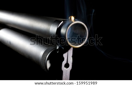 Smoke that is coming from a shotgun barrel - stock photo