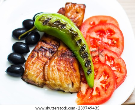 Smoked And Grilled Fish Carp with Grill Green Pepper Tomato and black Olive. - stock photo