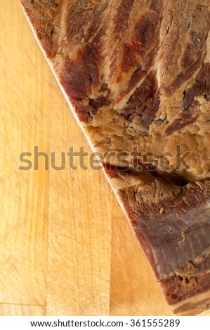 Smoked bacon on wooden background.