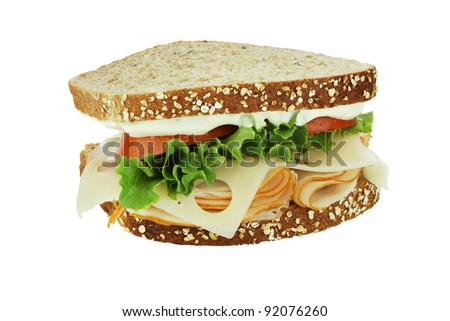 Smoked chicken sandwich with lettuce, tomato and swiss cheese on whole grain bread isolated on a white background. Clipping path included. - stock photo
