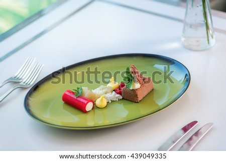 Smoked chocolate mousse, poached pear, chantily-raspberry log. Delicious asian dessert. - stock photo