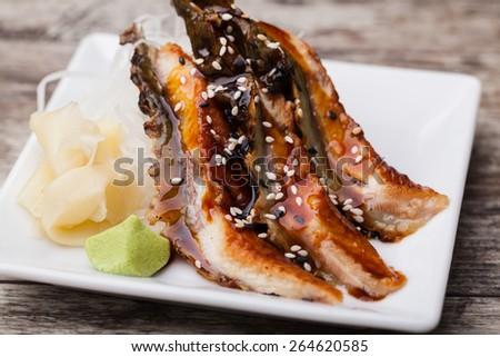 smoked Eel sashimi with withe plate - stock photo