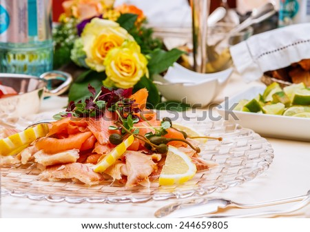 smoked fish platter served with fresh lettuce and garnished with lemon wedges