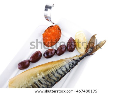 smoked fish served on plate with red caviar