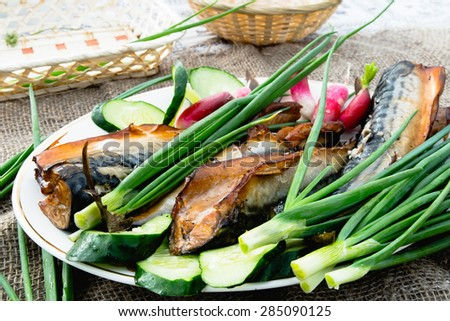 smoked fish with a variety of vegetables on a platter