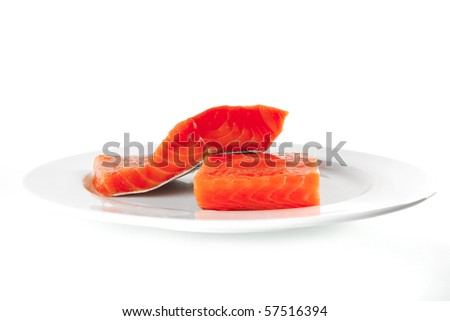 smoked fresh salmon piece on a big white dish