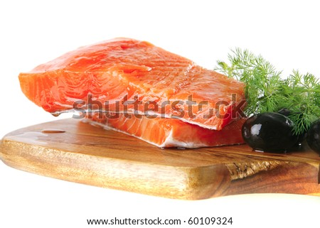 smoked fresh salmon piece with olives and white cheese - stock photo