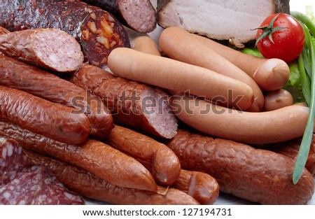 Smoked meat and sausages salami - stock photo