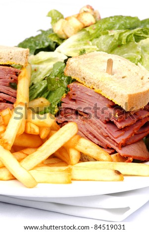 Smoked meat sandwich with fries and Cesar salad