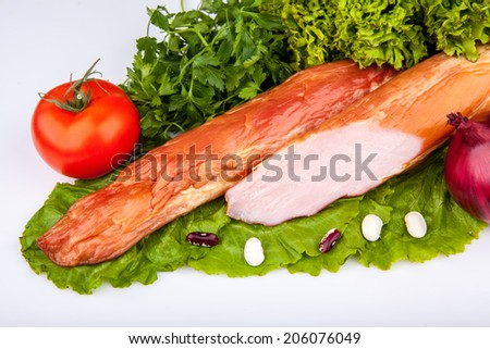 smoked meat with green vegetables on a white background