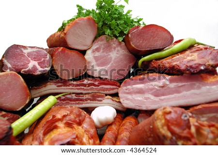 Smoked meat with paprika, bulb and parsley decoration - stock photo