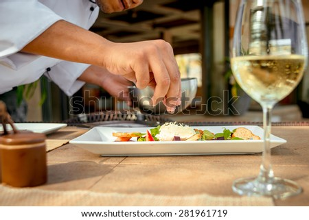 Smoked meat with vegetables and croutons on a white plate. The Restaurant - stock photo